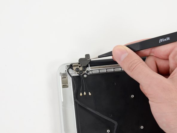 Image 2/2: Use a pair of tweezers to lift the rubber hinge covers up off the right and left display hinges.