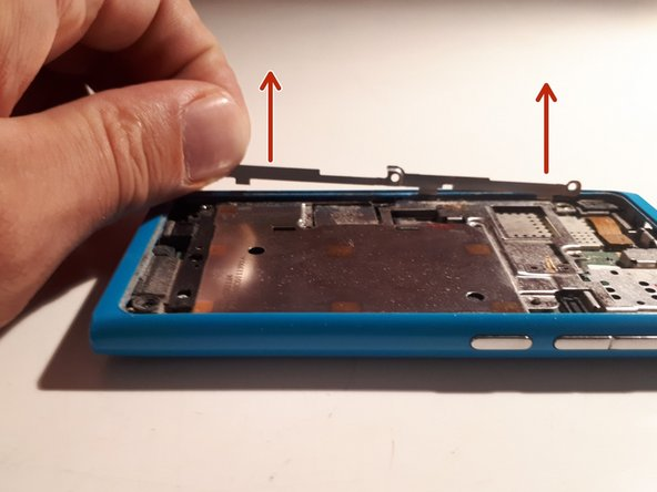 You will see a strip holding the larger battery cover in place at one side.