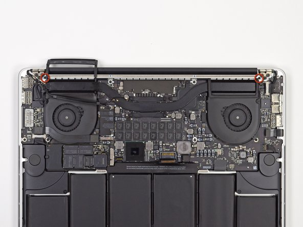 Image 1/2: Remove the two aluminum hinge brackets from the MacBook Pro.