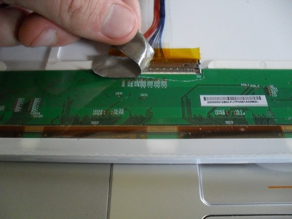 Image 2/3: Remove the display cable from the panel