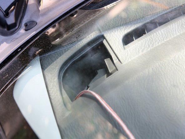 Start routing your tweeter speaker cable from through the hole on top of the dash.