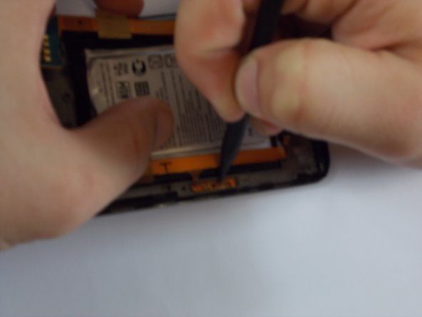 Make sure you pay attention when removing the left flex cable because it is also connected to the side. Simply just peal this part away also. It may be a little more difficult than the upper connections, but just peel away. It may bend a little but be careful not to break.