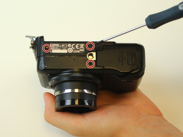 Remove the three screws on the bottom of the camera using a Phillips-head 00 screwdriver.