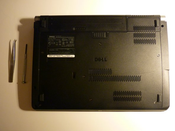 Image 2/3: Flip over laptop, and remove battery as a safety precaution