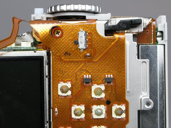 Remove the 3.4mm screw inside a deep hole on the back copper panel beneath the circular mode switcher.