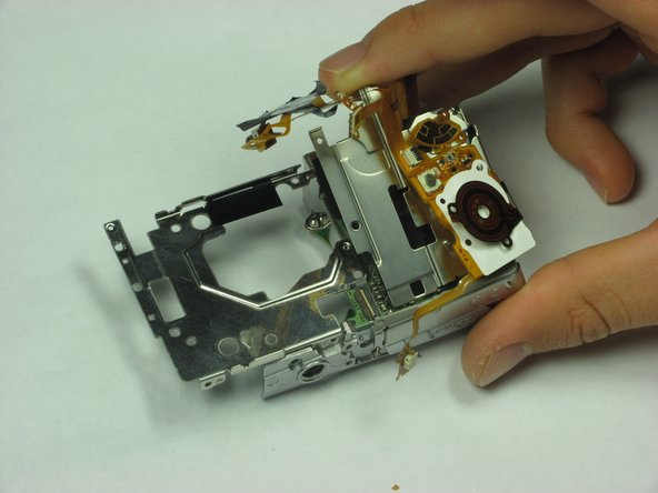 The whole ribbon and metal casing can now be easily removed from the remains of the camera.