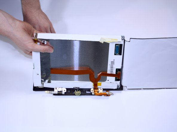 Lift the entire paper and monitor assembly out of its casing. Then, lift the actual monitor out of its paper shell. Be careful not to rip the paper. Watch out for any other wires that might get caught and the speaker cable which is connected to a speaker in the front of the monitor casing.