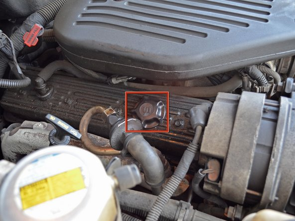 Locate the oil filler cap on the passenger side valve cover.
