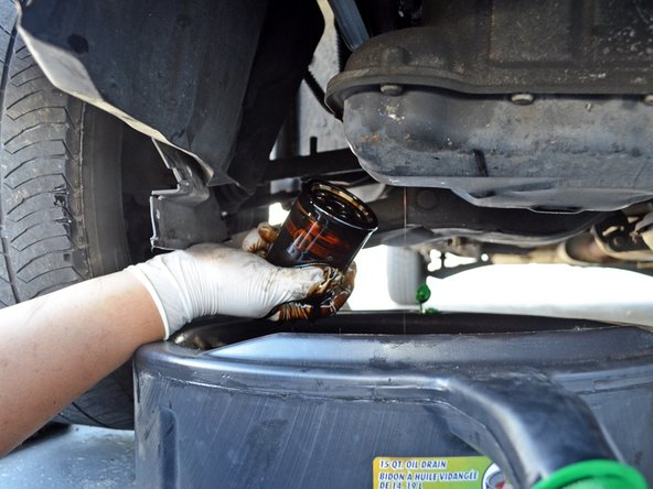 If the filter is too tight to loosen by hand, use an oil filter wrench. A wrench that fits over the top of the oil filter is ideal, as there is very little space on the sides of the oil filter.