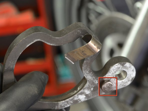 Make sure that the floating caliper spring is in the proper place before re-installing the floating caliper.