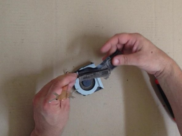Image 2/3: Clean the radiator and the fan. Use a soft brush.