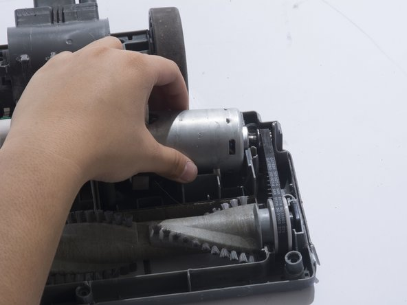 Remove the belt, found on the right hand side, from the motor gear.