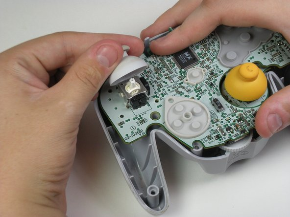 Pull off the grey joystick cover.