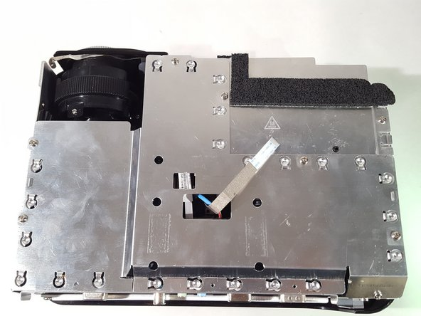 Unscrew the screws from the metal shielding to remove it.