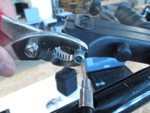 Use pliers to unfasten the bolt from the plastic handle.