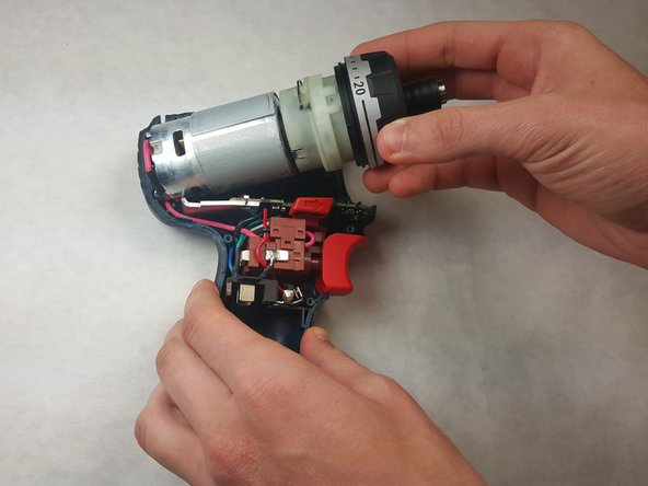 Image 1/2: Carefully remove the gearbox from the motor assembly.