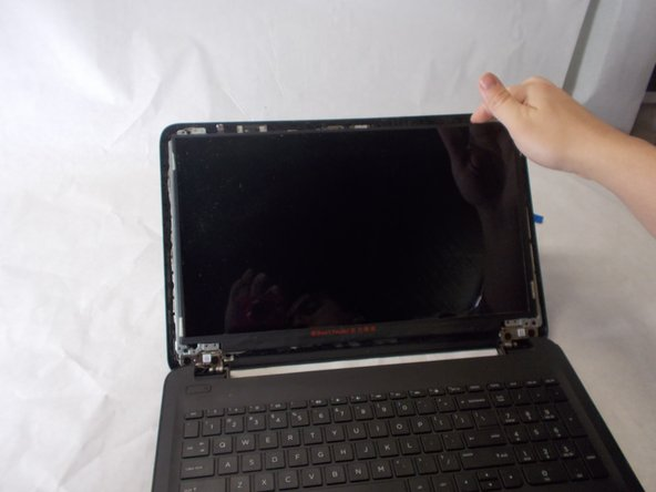 Remove the touchscreen from the laptop.