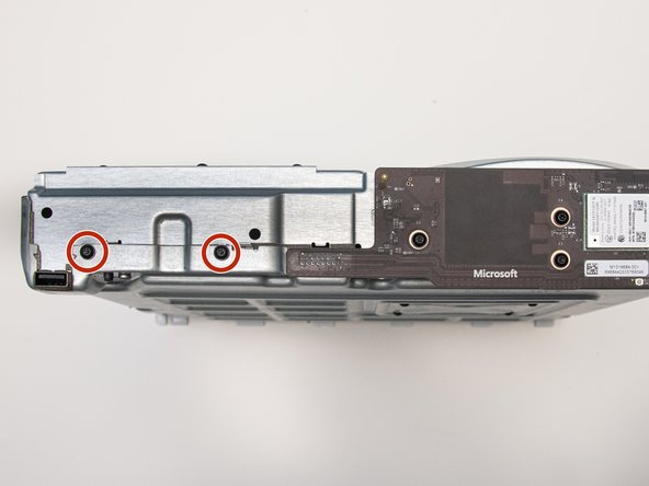 Remove the two 15mm screws from the front panel using the Torx T8 screwdriver.