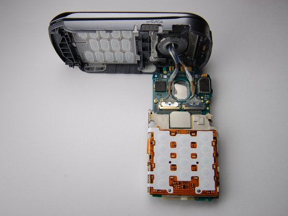 Use the plastic opening tool to carefully pry out the circuit board once you have removed the back cover.