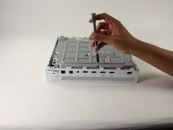 Take the T10 Torx screwdriver and remove the six 50 mm long screws.