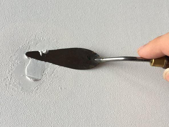 Evenly spread the texture paste in, over, and around the cut. The smoother you can make the edges of your paste, the easier it will be to clean up later. The paste usually takes about an hour or two to dry fully. The goal here is to fully mask the cut with paste.