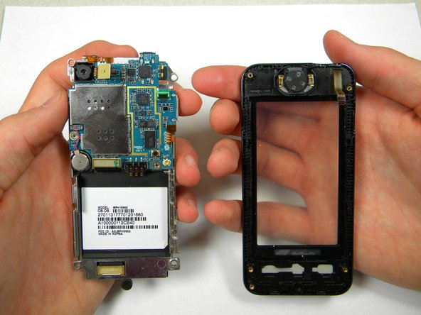 After removing lifting up on the motherboard, the front casing and center frame should be separated as shown.