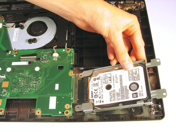 Once it is free, remove the hard drive from its internal cavity.