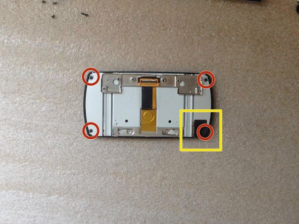 Unscrew the 4x screws.