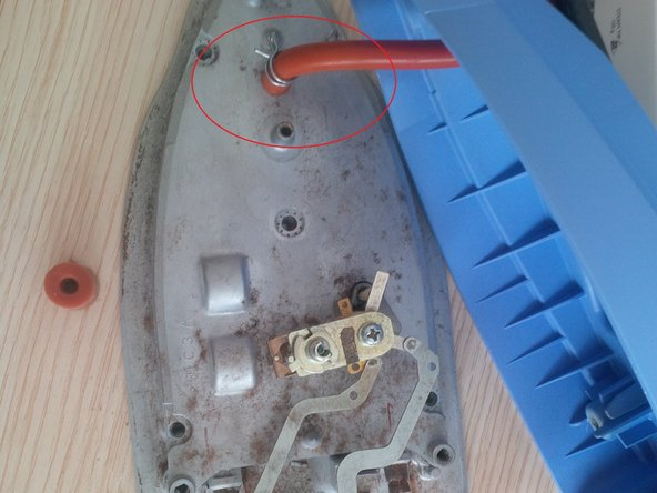 remove the rubber wire (red/orange color) and the metal pin arround it.