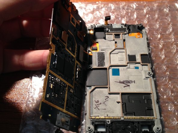 Lift the logic board from the right side, be careful not cause any damage to gently rotate the LCD connector.