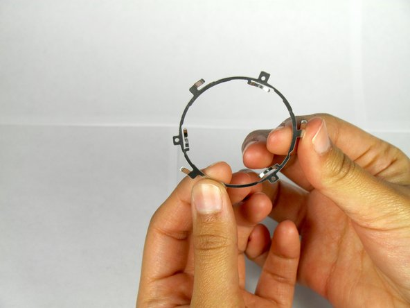 Remove the thin metal ring.