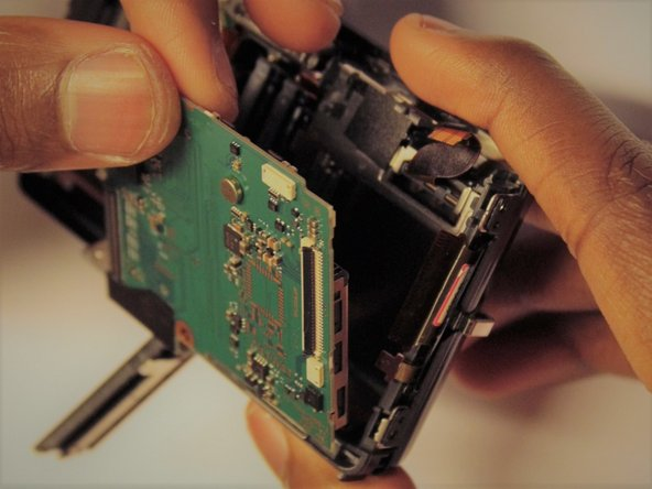Carefully remove the Memory card circuit board.