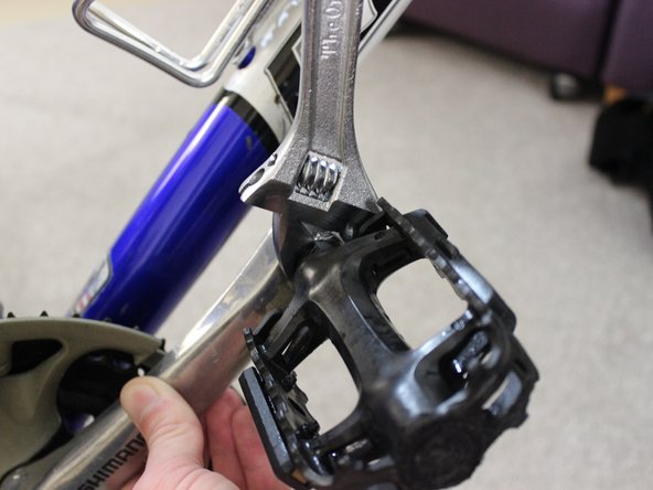 To unscrew the pedal that is on the side away from the chain, twist the wrench clockwise.