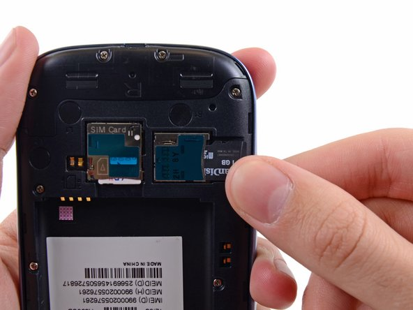 Image 1/2: Remove the microSD card from the phone.
