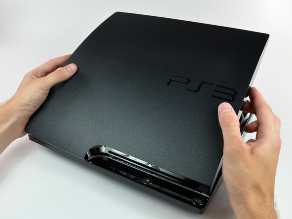 Flip the PS3 over.