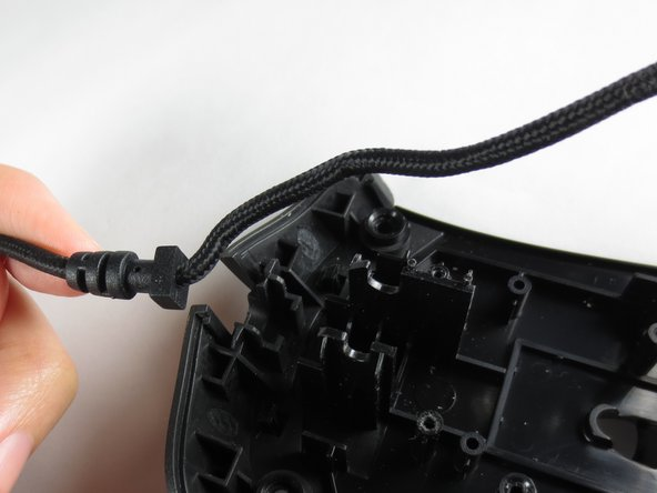 Remove the USB cable by pulling it up and out.