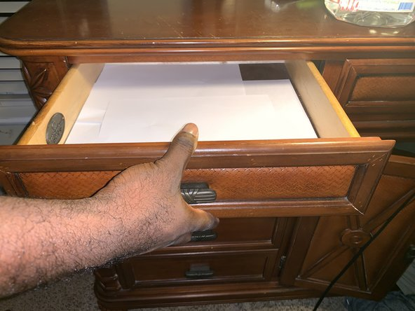 Place the drawer back in the cabinet/dresser.