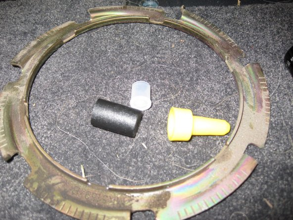 Image 2/2: Temporarily place a new fuel tank gasket on the fuel filter assembly (the gasket is orange)