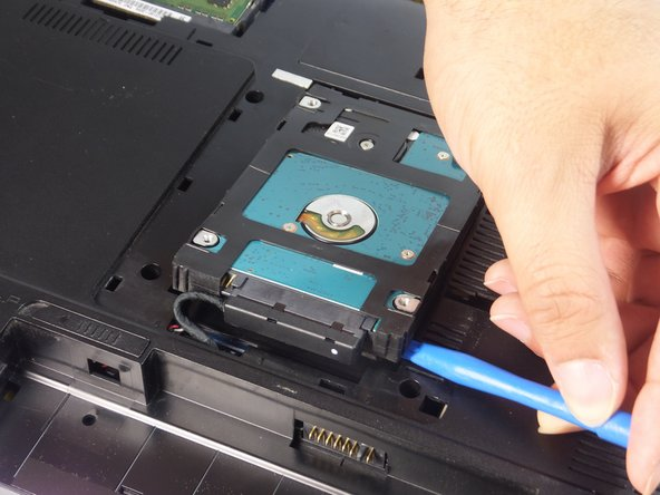Carefully lift the HDD up using plastic opening  tool.