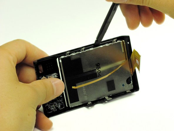It may be necessary to wiggle the spudger a little it to loosen the adhesive that holds the LCD screen to the back cover.