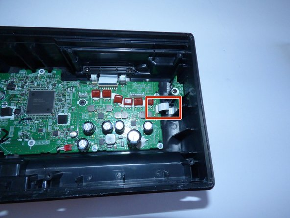 Image 1/2: Unscrew the 10mm Philips J1 Screw from the guard above the bluetooth chip.