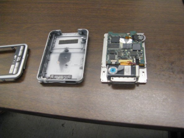 3. Pull the screen out of the back case with iPod opening  tool. The device should now be in three different parts.