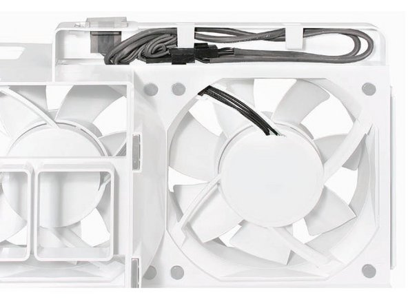 Image 2/2: Replacement Note: Before re-installing the front fan assembly in the enclosure, make sure that the fan cables are routed correctly in the fan channel. This can also be slightly tricky so pay attention to the alignment of the connectors on the fan unit and logic board.