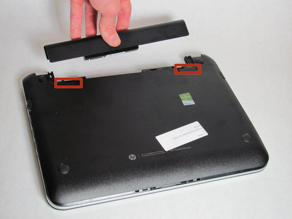 Remove battery by pushing the two tabs and pulling the battery outwards slowly but firmly.