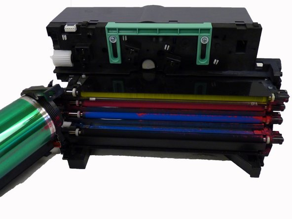 Slide each toner transfer unit out separately, placing all aside except for the black toner transfer unit.