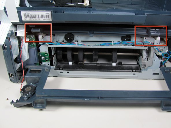 Press down on the two plastic hinges to remove the upper portion of printer.