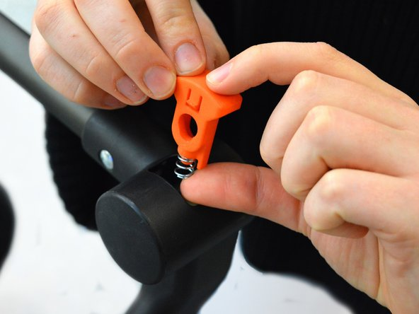 Put the new part with the spring back inside the cylinder, in the orientation shown in the picture.