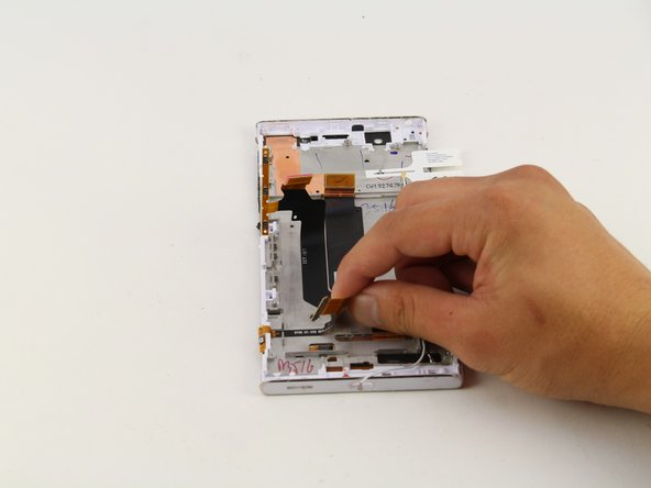 Peel off the power button flex with your hands.
