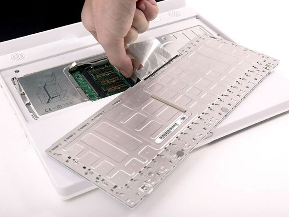 Image 1/1: Make sure that you reconnect the keyboard cable before replacing the RAM shield.
