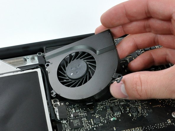 Image 3/3: Remove the right fan from the case.